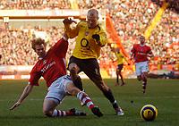 Photo: Glyn Thomas.<br />Charlton Athletic v Arsenal. The Barclays Premiership.<br />26/12/2005.<br /> Charlton's Jonathan Spector (L) and Arsenal's Fredrik Ljungberg.