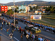 The caravan carrying the ashes of Cuban leader Fidel Castro approaches Santa Ifigenia cemetery, Castro's final resting place in Santiago de Cuba on Sunday, December 4, 2016.