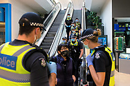 MELBOURNE, VIC - SEPTEMBER 20: Large numbers of police descend into the lower levels of the Chadstone Shopping Centre after a small protest group dispersed during a series of pop up Freedom protests on September 20, 2020 in Melbourne, Australia. Freedom protests are being held in Melbourne every Saturday and Sunday in response to the governments COVID-19 restrictions and continuing removal of liberties despite new cases being on the decline. Victoria recorded a further 14 new cases overnight along with 7 deaths. (Photo by Dave Hewison/Speed Media)