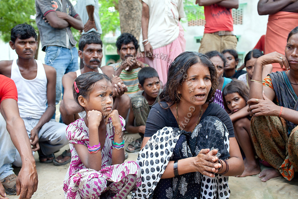 Geeta, (right) around 40 years old, is recounting how her younger daughter Radhika, 4, was kidnapped, raped and murdered on July 7th-8th, while her other daughter, Poonam, 8, (left) is sitting next to her, on a road inside Pakkatalab colony, in Lucknow, Uttar Pradesh. Radhika was kidnapped out of the family's house, nobody noticed. Her mother, Geeta, woke up at around 2am on July 8th and went searching for her younger daughter. She also went to the police, but they didn't do anything to help finding the girl. Geeta found her girl on the street, already dead. According to 'The Times of India', around 60 wounds were found on the girl's body. Instead of filing an official case, (FIR) the police told the mother that street dogs had killed her child. The post-mortem examination showed differently, and also proved that Radhika was raped. After some street demonstrations, the two police officers involved were suspended, and the police have now started searching for evidence. A destitute woman, Geeta makes and sells stones that are used as a flat base where to shred and chip vegetables. Her husband, Raju, died 3 years ago.