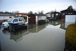 © Licensed to London News Pictures. 03/02/2021. Chertsey, UK. Residential properties flooded in Laleham Reach, Surrey where water levels along the Thames have risen over night. Large parts of the UK experience more wet conditions which is expected to bring further flooding. Photo credit: Ben Cawthra/LNP