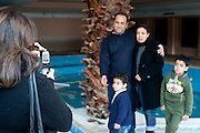 Gammarth, Tunisia. January 29th 2011.A family poses for a picture in the destroyed house of Belhassen Trabelsi who is Leila Trabelsi's older brother..People walked around and take pictures in the house with family and friends.....