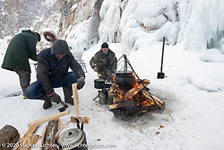 Preparing fish stew on an island in the middle of Lake Baikal after the Baikal Mile Ice Speed Festival. Maksimiha, Siberia, Russia. Sunday, March 1, 2020. Photography ©2020 Michael Lichter.