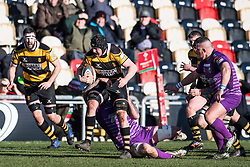 Newport's Alex Everett is tackled by Ebbw Vale's Rhys Clarke - Mandatory by-line: Craig Thomas/Replay images - 04/02/2018 - RUGBY - Rodney Parade - Newport, Wales - Newport v Ebbw Vale - Principality Premiership