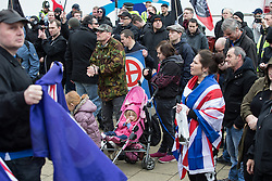 "© Licensed to London News Pictures . 21/03/2015 . Newcastle , UK . A child in the crowd . Neo-Nazis and skinheads from across Europe organise a "" White Man March "" in Newcastle , under the banner of "" National Action "" . Photo credit : Joel Goodman/LNP"
