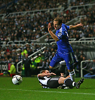 Photo: Andrew Unwin.<br /> Newcastle United v Chelsea. Carling Cup. 20/12/2006.<br /> Chelsea's Arjen Robben (R) is fouled by Newcastle's Nicky Butt (L).
