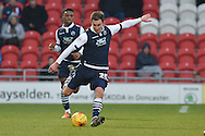 Jed Wallace of Millwall FC kicks forward  during the Sky Bet League 1 match between Doncaster Rovers and Millwall at the Keepmoat Stadium, Doncaster, England on 27 February 2016. Photo by Ian Lyall.