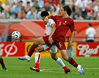 Photo: Glyn Thomas.<br />Portugal v Iran. Group D, FIFA World Cup 2006. 17/06/2006.<br /> Portugal's Fernando Meria (R) and Iran's Vahid Hashemian.