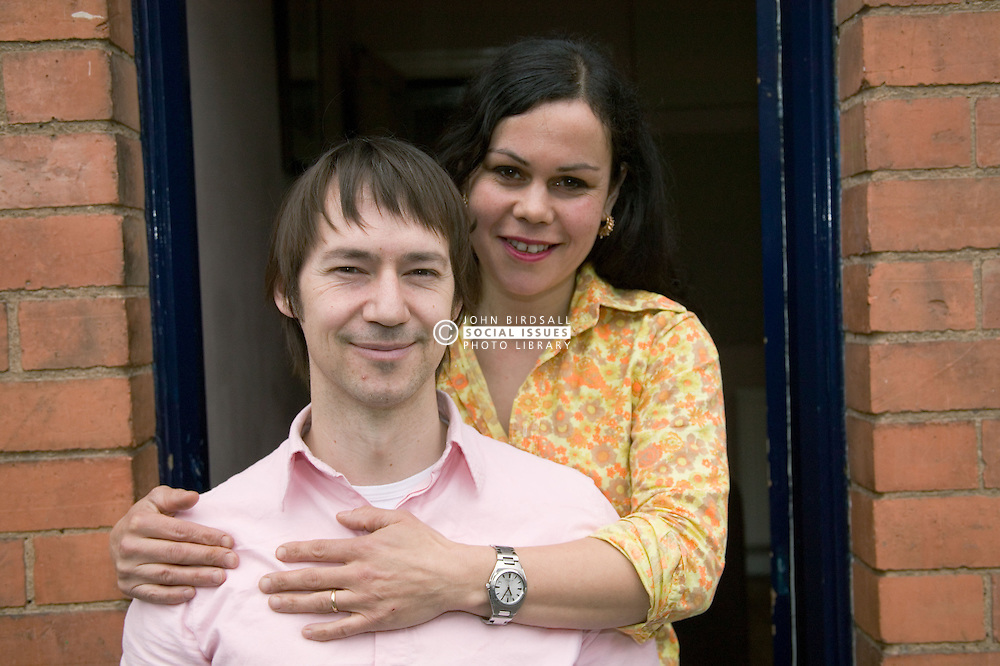 Husband and wife; looking happy,