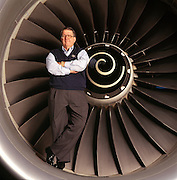 Harry C. Stonecipher, Vice Chairman of Boeing in the engine of a Boeing 777 in Washington State