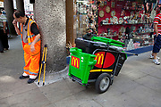 Outside MacDonalds on Shaftesbury Avenue in the West End, a MacDonalds worker street sweeper cleans up litter.