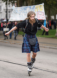 © Licensed to London News Pictures. 07/10/2019. London, UK. An Extinction Rebellion protestor makes his way through Whitehall in rollerblades. Activists will converge on Westminster blockading roads in the area for at least two weeks calling on government departments to 'Tell the Truth' about what they are doing to tackle the Emergency. Photo credit: Ben Cawthra/LNP