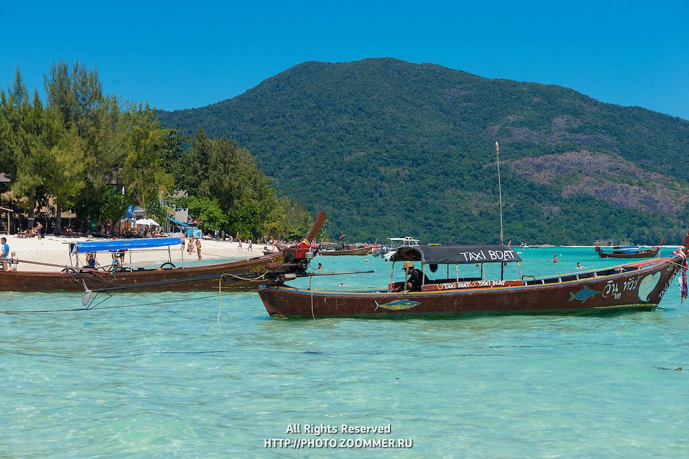 Longtail taxi boats on Sunrise beach, Ko Lipe, Thailand