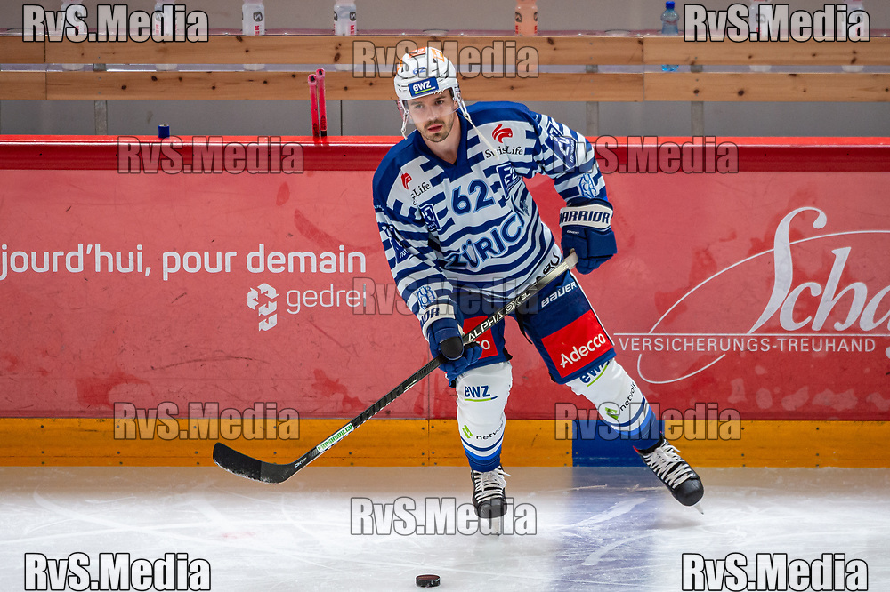 LAUSANNE, SWITZERLAND - OCTOBER 01: Denis Malgin #62 of ZSC Lions warms up prior the Swiss National League game between Lausanne HC and ZSC Lions at Vaudoise Arena on October 1, 2021 in Lausanne, Switzerland. (Photo by Robert Hradil/RvS.Media)