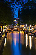 Canal and bridge at Kaisersgracht and Leidsegracht in canal ring area, Jordaan district, Amsterdam