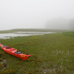 A kayak next to a salt marsh in Marquoit Bay, Brunswick, Maine.