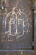 graffiti drawing of shirt on rusty door