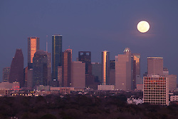 Full moon rising over Houston, Texas skyline.