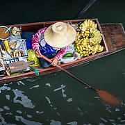 Overhead view of market vendor in boat at Damnoen Saduak floating market