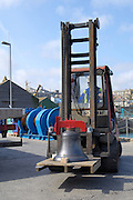 UK, Penzance - Monday, March 23, 2009: A fork lift moves one of the bells on to the quayside before loading onto the Isles of Scilly Steamship Company's supply vessel the Gry Maritha to be transported to St Mary's on the Isles of Scilly. (Image by Peter Horrell / http://www.peterhorrell.com)