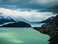 A storm over Glaciar Grey casts broken light over Lago Grey, located in Torres del Paine National Park, Chile.
