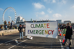 London, UK. 17th November, 2018. Environmental campaigners from Extinction Rebellion block Westminster Bridge, one of five bridges blocked in central London, as part of a Rebellion Day event to highlight 'criminal inaction in the face of climate change catastrophe and ecological collapse' by the UK Government as part of a programme of civil disobedience during which scores of campaigners have been arrested.
