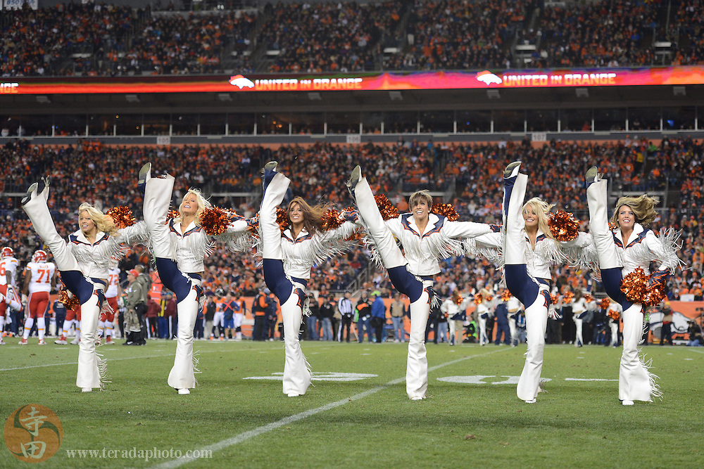 November 17, 2013; Denver, CO, USA; Denver Broncos cheerleaders (L-R) Lindsey, Tristan, Liz, Sam, Candace, and Christina C. perform during the first quarter against the Kansas City Chiefs at Sports Authority Field at Mile High. The Broncos defeated the Chiefs 27-17.