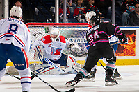 KELOWNA, BC - SEPTEMBER 21:  Kyle Topping #24 of the Kelowna Rockets opens the scoreboard with a goal on Campbell Arnold #1 of the Spokane Chiefs  at Prospera Place on September 21, 2019 in Kelowna, Canada. (Photo by Marissa Baecker/Shoot the Breeze)