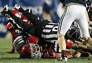 Utah runningback John White, bottom, upends a referee after a 12-yard gain during the second half of an NCAA college football game against BYU, Saturday, Sept. 17, 2011, at LaVell Edwards Stadium in Provo, Utah. Utah defeated BYU 54-10. (AP Photo/Colin E Braley)..