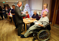 Prince Charles (known as The Duke of Rothesay when in Scotland) chats with patient Charles Lundie during his visit to the Ayrshire Hospice in Ayr where he met patients and their families, staff and volunteers.