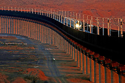 """File photo taken on Nov. 24, 2015 shows a bullet train running on the Lanzhou-Xinjiang high-speed railway, in northwest China's Xinjiang Uygur Autonomous Region. """"Building more high-speed railways"""" has been a hot topic at the annual sessions of China's provincial legislatures and political advisory bodies intensively held in January. China has the world's largest high-speed rail network, with the total operating length reaching 19,000 km by the end of 2015, about 60 percent of the world's total. The expanding high-speed rail network is offering unprecedented convenience and comfort to travelers, and boosting local development as well. Chinese companies have developed world-leading capabilities in building high-speed railways in extreme natural conditions. High-speed railway routes across China have been designed to suit its varying climate and geographical conditions. The Harbin-Dalian high-speed railway travels through areas where the temperature drops to as low as 40 degree Celsius below zero in winter, the Lanzhou-Xinjiang railway passes through the savage Gobi Desert and the Hainan Island railway can withstand a battering from typhoons. The China Railway Corp. plans to spend another 800 billion yuan (around 120 billion U.S. dollars) in 2016, especially in less-developed central and western regions. EXPA Pictures © 2016, PhotoCredit: EXPA/ Photoshot/ Cai Zengle<br /><br />*****ATTENTION - for AUT, SLO, CRO, SRB, BIH, MAZ only*****"""