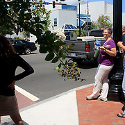 SIndy Hernandez, left, waits to cross the street during a protest at the coursthouse on 3rd street in Wilmington, N.C. on Monday August 12, 2013. The group later marched to the law office of Thom Goolsby in protest of Goolsby's support of abortion restrictions being inserted into a bill abou motorcycle safety. (Jason A. Frizzelle