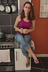 Relaxing in kitchen with a cup of tea,