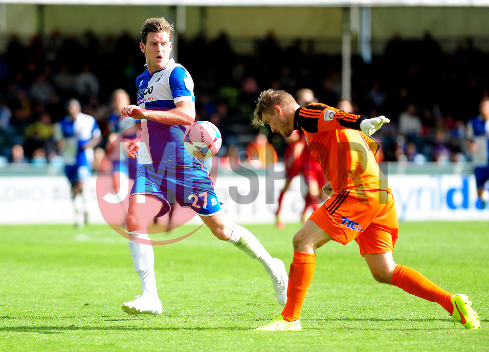AFC Telford's Jonathan Hedge heads cleard from Bristol Rovers' Adam Cunnington - Photo mandatory by-line: Neil Brookman - Mobile: 07966 386802 23/08/2014 - SPORT - FOOTBALL - Bristol - Memorial Stadium - Bristol Rovers v AFC Telford - Vanarama Football Conference