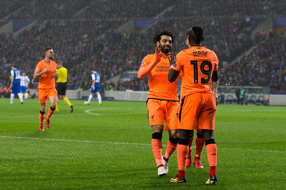 Liverpool's Sadio Mane celebrates scoring his side's third goal with team mate Mohamed Salah <br /> <br /> Photographer Craig Mercer/CameraSport<br /> <br /> UEFA Champions League Round of 16 First Leg - FC Porto v Liverpool - Wednesday 14th February 201 - Estadio do Dragao - Porto<br />  <br /> World Copyright © 2018 CameraSport. All rights reserved. 43 Linden Ave. Countesthorpe. Leicester. England. LE8 5PG - Tel: +44 (0) 116 277 4147 - admin@camerasport.com - www.camerasport.com