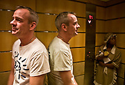 Fatboy Slim in a hotel lift with a cleaner during a tour in Johannesburg, South Africa, 2007.