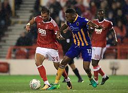 Nottingham Forest's Apostolos Vellios (left)  and Shrewsbury Town's Ebou Adams battle for the ball