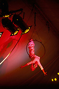 A trapeze artist takes applause from the audience during her act in Gifford Circus, Marlborough, UK