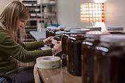 Labeling jars of Quince & Apple's Figs and Black Tea preserves. (Photo © Andy Manis)
