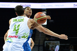 Jure Balazic of Slovenia vs  Ioannis Antetokounmpo of Greece during friendly match between National Teams of Slovenia and Greece before World Championship Spain 2014 on August 17, 2014 in Kaunas, Lithuania. Photo by Robertas Dackus / Sportida.com