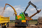 The lorry mounted wood chipper (HEIZOHACK HM 14-800 K) can chip about 5 logs at a time ready for use in wood chip boilers for Suffolk county council sustainable wood chip production, Suffolk.