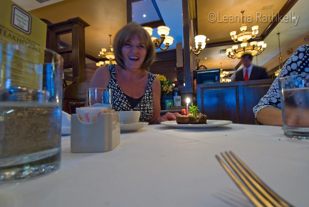 Carol celebrates her belated birthday at a restaurant in New York.