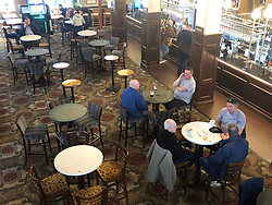 © Licensed to London News Pictures. 17/03/2020. Leeds UK. People in Beckett's Bank a Wetherspoons pub in Leeds city centre this morning after yesterdays announcement that people should work from home & everyone should avoid pubs, clubs & restaurants. Photo credit: Andrew McCaren/LNP