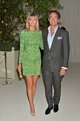 TIM & MALIN JEFFERIES at a dinner hosted by Cartier in celebration of The Chelsea Flower Show held at The Hurlingham Club, London on 19th May 2014.
