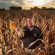 Don Lamb holds ears of pop corn in one of his Lamb Farms fields in Lebanon, Indiana. Lamb farms 10,000 acres of different types of corn and beans west of Indianapolis. Nathan Lambrecht/Journal Communications