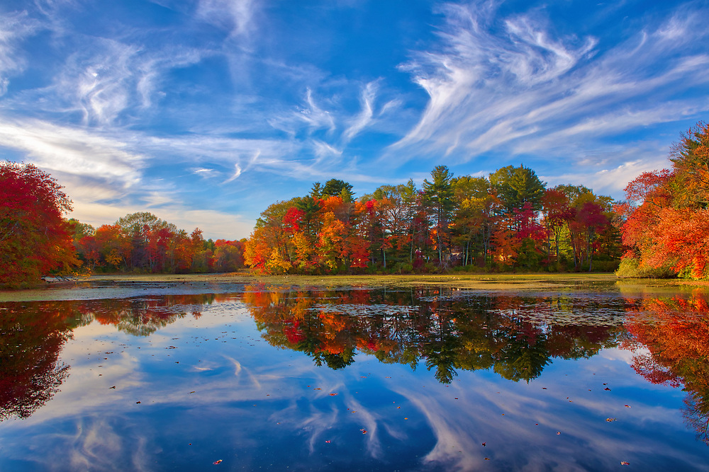 New England fall foliage brilliance at the Factory Pond in Holliston, MA. This autumn photo was inspired by the red glorious fall colors and amazing pond reflection. The photograph was taken at the site where the Darling Woolen Mill stood. The mill was lost to a fire in 1933. <br /> <br /> 2017 New England fall foliage season photos are available as museum quality photo, canvas, acrylic, wood or metal prints. Wall art prints may be framed and matted to the individual liking and interior design decoration needs:<br /> <br /> https://juergen-roth.pixels.com/featured/factory-pond-holliston-ma-juergen-roth.html<br /> <br /> Good light and happy photo making!<br /> <br /> My best,<br /> <br /> Juergen<br /> Licensing: http://www.rothgalleries.com<br /> Photo Prints: http://fineartamerica.com/profiles/juergen-roth.html<br /> Photo Blog: http://whereintheworldisjuergen.blogspot.com<br /> Instagram: https://www.instagram.com/rothgalleries<br /> Twitter: https://twitter.com/naturefineart<br /> Facebook: https://www.facebook.com/naturefineart