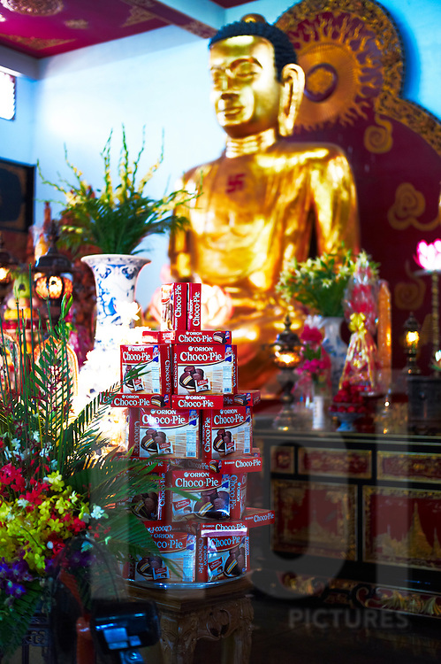 Choco Pie cakes are piled up as offers in a temple, Ho Chi Minh City, Vietnam, Southeast Asia