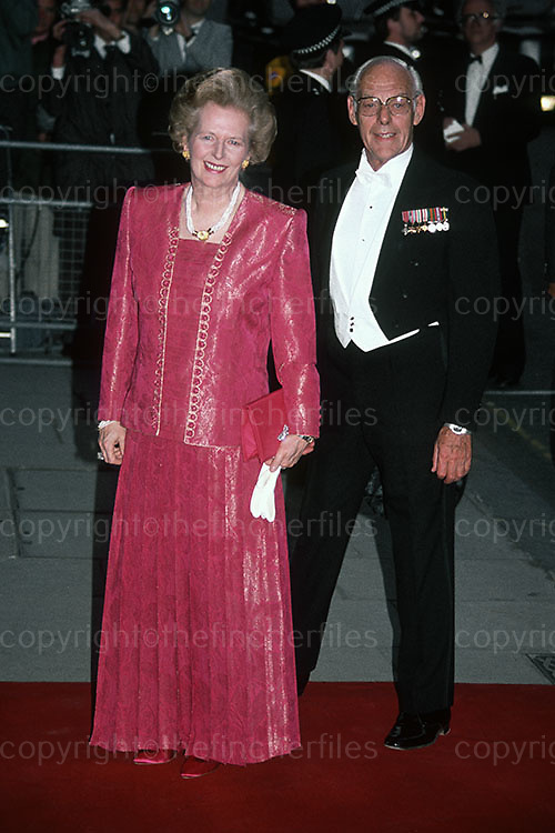 Margaret Thatcher and husband Dennis Thatcher seen arriving at Claridges Hotel for a  banquet for President of Nigeria, London May 1989. Photograph by Jayne Fincher