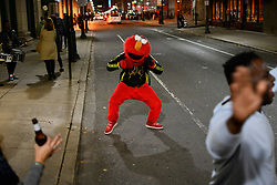 A person in an Elmo custom is seen dancing on the street as Governor Tom Wolf, Senator Bob Casey and Lieutenant Governor candidate John Fetterman visit the LGTBQ bar Woody's during a state wide bus tour to camping for the reelection of Wolf and Casey, in Philadelphia, Pennsylvania, USA, 03 November 2018. Wolf faces a challenge from Businessman Scott Wagner and Senator Casey is challenged by Representative Lou Barletta in the 06 November general election.