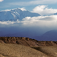 A winter snowstorm clears over White Mountain Peak and the Volcanic Tablelands in California's Owens Valley.